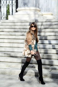 Over the knee boots, furry gilet & waxy jeans