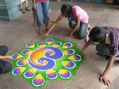 How to draw kolam/rangoli: 1. Make the dots with chalk on the floor. 2. Use dots to guide you to draw the patterns. 3. Fill the lines with colored rice paste.