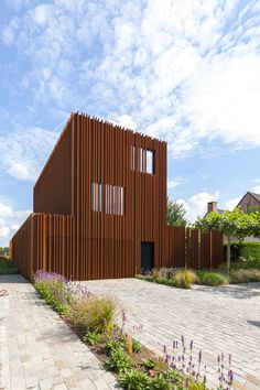 Built by DMOA Architecten  in Kontich, Belgium with date 2013. Images by Luc Roymans. In this house in the suburbs of Antwerp, weathering steel lamellae are in command. Inside as well as outside they def...