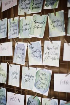 Watercolor escort card idea - blue and green watercolor with guests' names written in calligraphy {Photo by Basia}