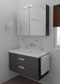 Kleine badkamer 200x187cm met dubbele wastafel.