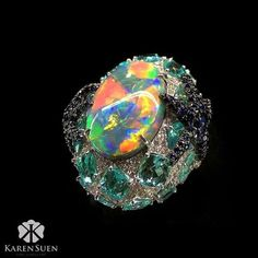 Do you see the starfish on the sides? Opal, Paraiba tourmaline and diamond ring by Karen Suen