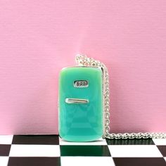 This is truly one very retro statement necklace, in tribute to the mother of all fridges the almighty Smeg Fridge we bring you the aptly named 'Smug' fridge locket necklace.