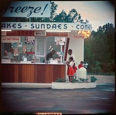 An ice cream stand in 1956 Alabama had separate windows for white and black customers in this photo by Gordon Parks. (Provided by and copyright The Gordon Parks Foundation)