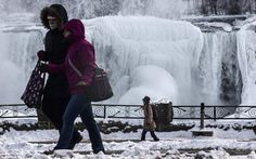 Niagara Falls comes to a halt AGAIN: Millions of gallons of cascading water is frozen in bitter temperatures By DAILY MAIL REPORTER PUBLISHED: 00:44 EST, 4 March 2014 Bundle up: People walk along the U.S. side of the Falls bundled up to protect against the subfreezing temperatures
