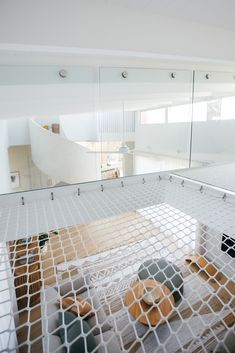 Kyal and Kara's rumpus room features windows on both sides dressed with DIY Blinds S Fold sheer curtains in Allusion Marzipan, with the gentle folds in the curtains mirroring the curves in the staircase. Beautiful Ceiling Designs, Kyal And Kara, White Exterior Houses, Upstairs Loft, Freestanding Fireplace, Diy Blinds, Stone Kitchen, Bed Lights, Toy Rooms