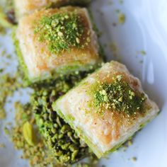Authentic Turkish Baklava  Buttery, flaky puff pastry soaked in honey and sugar with tender pistachios stuffed between layers of dough.  This Baklava recip