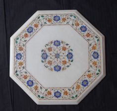 Marble Marquetry Lapis Lazuli inlaid Pietra Dura. The marble stone is first traced with the pattern of brass sheet. The pattern may be of any shape, design or size. The quarried marble is then cut to size and painstakingly sculpted.