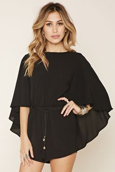 A semi-sheer woven romper with a cape overlay creating elbow-length sleeves, a round neckline, a V-cutout back, and a tasseled self-tie belt at its elasticized waist. Rompers Women, Jumpsuits For Women, Forever 21 Romper, Boho Fashion, Fashion Outfits, Playsuit Romper, Long Sleeve Romper, Passion For Fashion, Casual Dresses