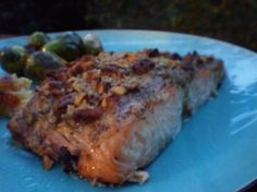 Baklava Salmon (Salmon With Honey, Butter, Walnuts, and Mustard).   I have also made this recipe using Pecans.  Great for Pork too!  I usually serve brown rice and aspargus (or broccoli) with it. Yummy!