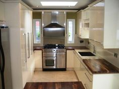 Cream high gloss/walnut kitchen