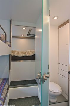 The double bed area behind the children's bed can be seen in this image, as well as the ba...