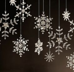 *snowflakes hanging by fishing line or tiny ribbons...