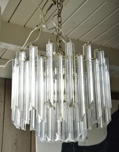 Mid-Century Lucite and Brass Chandelier | From a unique collection of antique and modern chandeliers and pendants  at https://www.1stdibs.com/furniture/lighting/chandeliers-pendant-lights/
