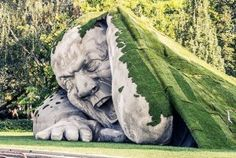 """Hungarian artist Ervin Loránth Hervé's new sculpture for Art Market Budapest literally rips out of the lawn at Széchenyi Square. The gigantic man, called """"Poppe. Sculpture Head, Pottery Sculpture, Garden Sculpture, Outdoor Sculpture, Metal Sculptures, Abstract Sculpture, Bronze Sculpture, Wood Sculpture, Fondation Cartier"""