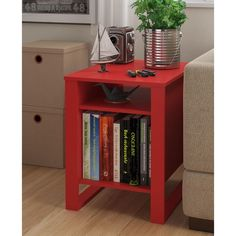 Create a pop of color in your room with the Altra Reese Accent Table. This modern accent table can brighten up any space with its ruby red finish. This accent table is just the right size to store all