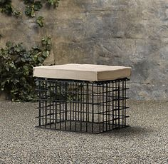 Wire Basket/Gambian with pillow - could be a stool, ottoman, or side table