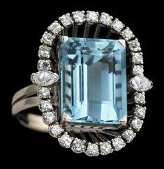 18 karat white gold, diamond and aquamarine ring, F&F Felger 1930s Step cut aquamarine prong set within unusual oval round cut diamond frame, either side displays a single petite marquise cut diamond.