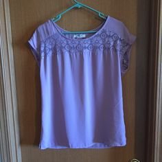 Summer top Cute summer blouse. Violet color with see through across front and back. Buttons 1/4 up the back. Romy Tops Blouses