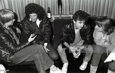 Journalist Rogier van Bakel (of Dutch music magazine OOR), Brian May and John Deacon of Queen and journalist Annemarie den Daas (of Dutch music magazine Hitkrant) on board a train (De Kameel) from Leiden to Amsterdam, Netherlands, after a gig at Groenoordhal, Leiden, 25th April 1982. photo by Rob Verhorst