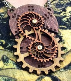 Stained Kinetic Nautilus Gear Pendant  by #SteamyTech #Steampunk