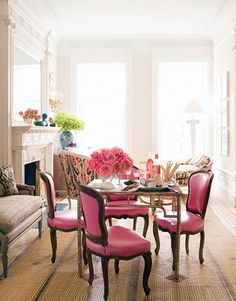 so feminine and french... green and pink flowers.. patterns, a cozy bench.. white walls.. what else could u want?