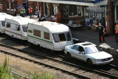 A car pulling RV's on a train track. Only on Top Gear!