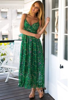 Full front view of model in green printed maxi dress