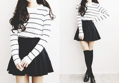 Cute monochromatic outfit with the white and black striped top, black flared skirt, and black over the knee tights.
