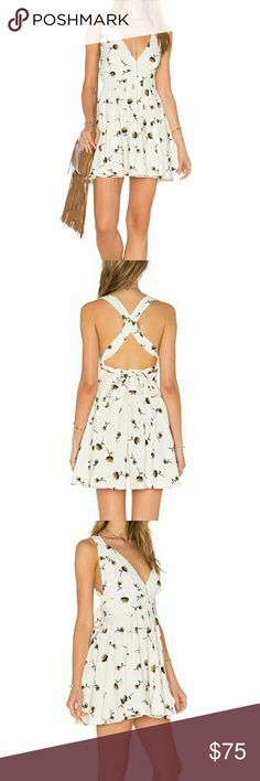 Free People Mini Dress NWOT Free People ivory mini dress with flower print and side zipper. Adjustable back straps, can be crisscrossed or worn as open back. Free People Dresses Mini