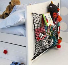 Kids Room Storage - Cargo Net Cargo netting: It's not just for camper vans! For an easy kids' room storage pouch, affix a net to a wall, the back of a door, or even the side of a bed. Shop online or at your local sporting goods store; choose netting that can hold smaller toys but is wide enough to make its contents plainly visible.