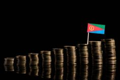 eritrean flag with lot of coins isolated on black background