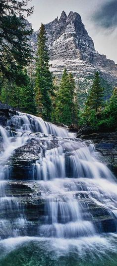 Waterfall in Glacier National Park, Montana, USA. Don't forget when traveling that electronic pickpockets are everywhere. Always stay protected with an Rfid Blocking travel wallet. https://igogeer.com for more information.