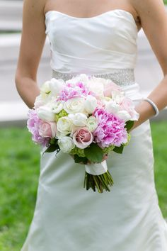 pink and white bouquet featuring peonies, roses, ranunculus, tulips and viburnum by Anthony Gowder