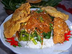Pecel is the typical food Madiun East Java Indonesia made of vegetable stew of spinach, bean sprouts, long beans, basil, leaves turi, Krai (a type of cucumber) or other vegetables are served with sauce doused pecel. The concept is similar to pecel dish salad for Europeans, ie fresh vegetables doused mayonnaise topping. It's just to pecel peanut sauce topping.