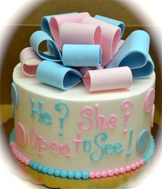 Surprise gender announcement cake. Boy or Girl ? Cake.  Have the tech write down the gender on a piece of paper.   Give it to the baker