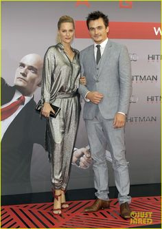 rupert friend hitman agent 47 berlin 03 Rupert Friend keeps close to his fiancee Aimee Mullins as they arrive for the premiere of his new movie Hitman: Agent 47 held at CineStar on Wednesday evening (August…