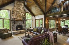 Perched on a sloped, wooded lot, the Eaveys' light-filled great room feels like a tree house.