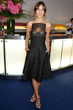 Alexa Chung is wearing a dress by Dior