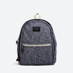 "Our best selling backpack in navy. Large enough for 15"" laptop and all your daily essentials. Our go-to backpack for those with style and organization in mind."