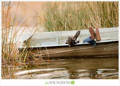 I love the use of the row boat and the lifestyle portraits used by The Youngrens in this engagement shoot. It inspires me to use my uncle's boat and pond for a couple of my own.
