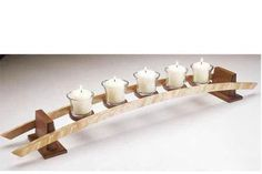 """This simple yet graceful stand for five votive candles measures 28"""" long and is sure to turn even the most casual dinner into a classy affair."""