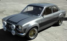 model of the classic Ford Escort, rendered with many different stripe and body colours. A slection of alloy wheels from classic RS Alloys to large racing BBS rims. Escort Mk1, Ford Escort, Retro Cars, Vintage Cars, Garage Workshop Plans, Triumph Motorcycles, British Sports Cars, Ford Classic Cars, Dirtbikes