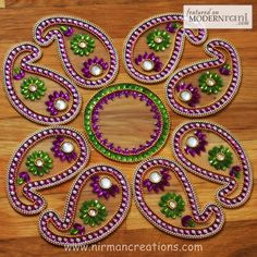 Beautiful kundan rangoli - made usually of colored powder, its made during the holidays!