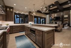 A Modern Rustic Kitchen - - Cameo Homes Inc. has recently built a modern rustic home in Draper, Utah and we wanted to share with you some of the pictures of the stunning kitchen in that home. Interior Design by Sita Montgome…. Residential Interior Design, Interior Design Kitchen, Home Decor Kitchen, Home Kitchens, Kitchen Modern, Staining Cabinets, Walnut Cabinets, Modern Rustic Homes, Modern Rustic Kitchens