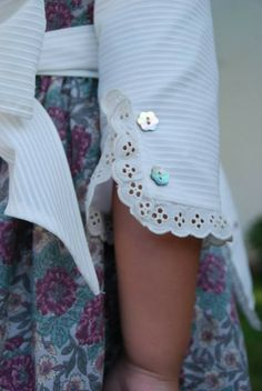 Pompones Ana, La Tienda...ideas for sleeve embellishments