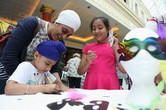 Kids getting involved in the free headdress making workshops at the 'Everyone's Invited' parade weekend at intu Trafford Centre. Children were invited to get involved in the workshops and then join the UK's largest parade as it went down the malls!