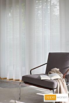 Luxaflex® Verticale lamellen, in meerdere breedtes en afwerkingen verkrijgbaar.