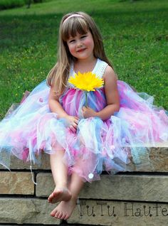 This adorable tutu dress is made from yards and yards of shimmery pastel colored tulle. Dress has white roses at the bust with pearl centers, and sequins scattered throughout for added sparkle. * This listing is available in tween sizes 12 to 16. Please list your desired size upon purchase.  * dress is not lined but is very full... it is recommended to wear a romper or shorts underneath for coverage. ** PLEASE NOTE: All items are made to order,$75.00