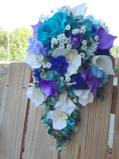 Hey, I found this really awesome Etsy listing at http://www.etsy.com/listing/157964231/cascading-bridal-bouquet-with-teal